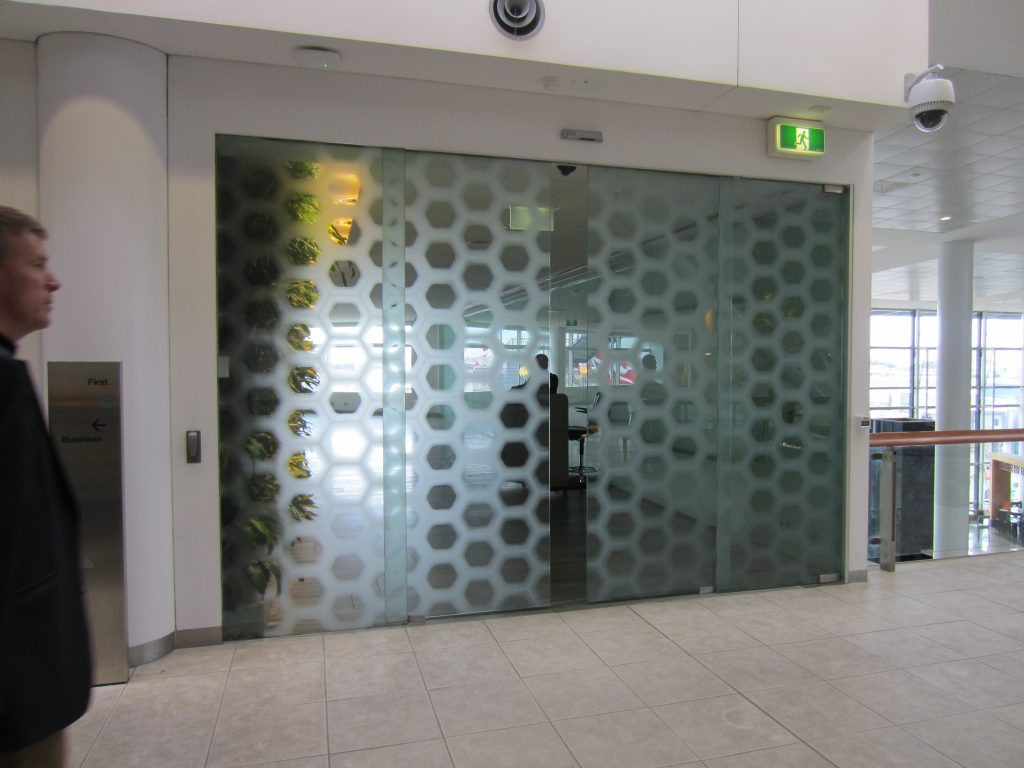 Glass door Qantas First Class Lounge